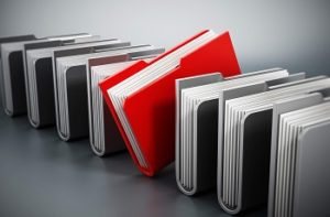 Red folder stands out among gray files.